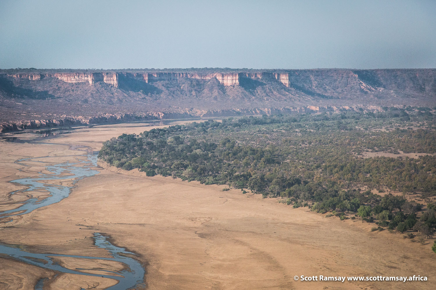 Flying over the Runde River, with the Chilojo Cliffs in the background. In dry season of winter (June to October), the river is very low (as pictured). In rainy season from January to March, the entire river floods.
