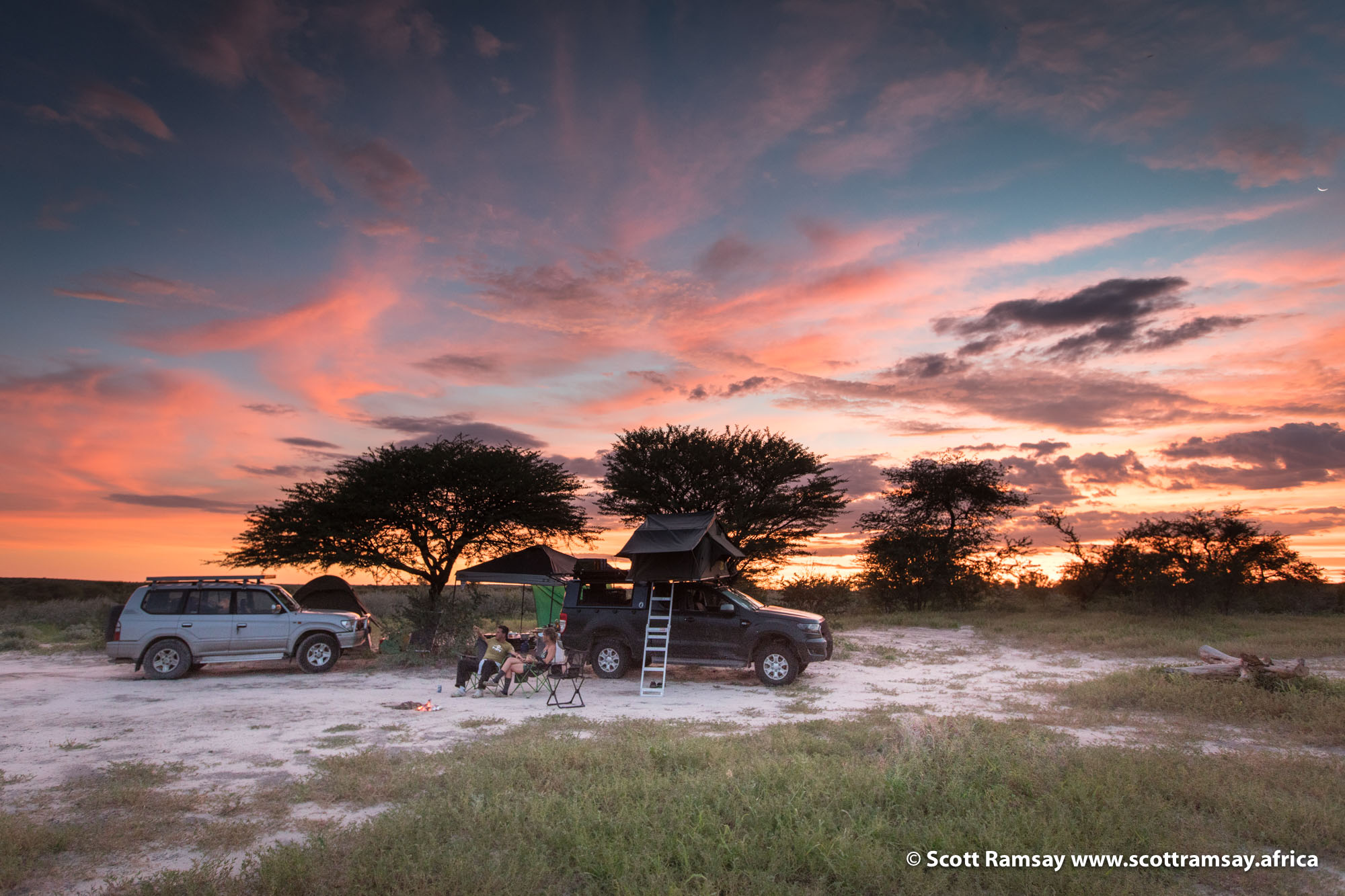Another day comes to an end, and another astonishing sunset in the Kalahari summer. Our campsite at Passarge Pan.