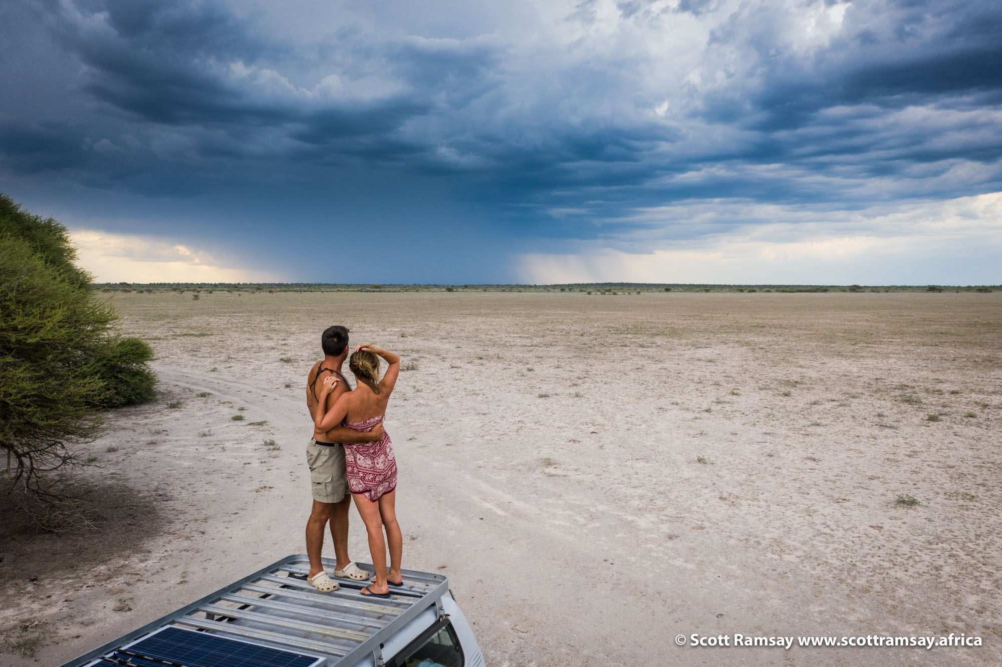 Ian and Joni watching a storm approaching across Leopard Pan, our last campsite of the trip.