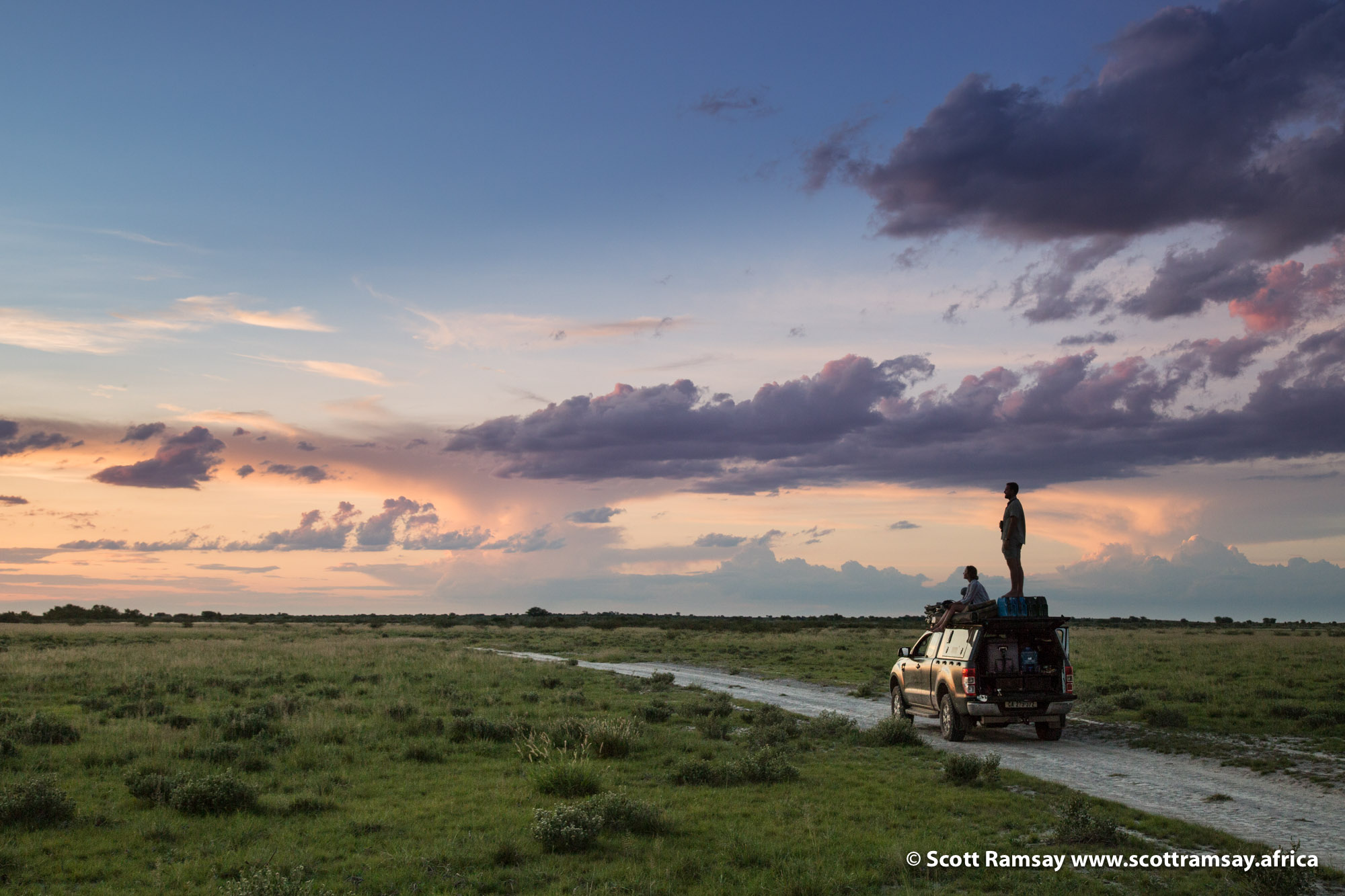 The feeling of freedom...once you've tasted it in the Central Kalahari, you won't go back to more popular parks where mass tourism has ruined the essence of a wilderness experience. My friends Ian and Joni enjoying a sundowner on top of my Ford Ranger near Letiahu Pan.
