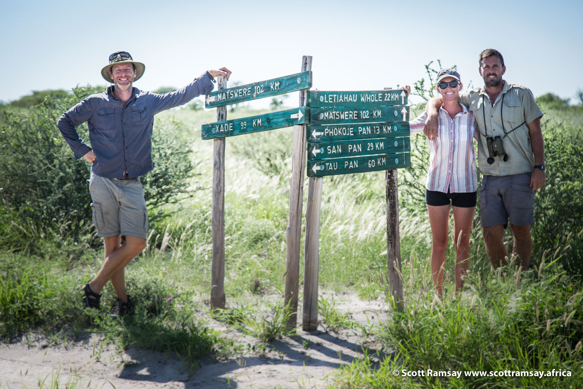 With my friends Ian and Joni, on our way to Piper's Pan. These signposts are the only man-made things in the reserve, along with long-drop loos and open-air bucket showers.