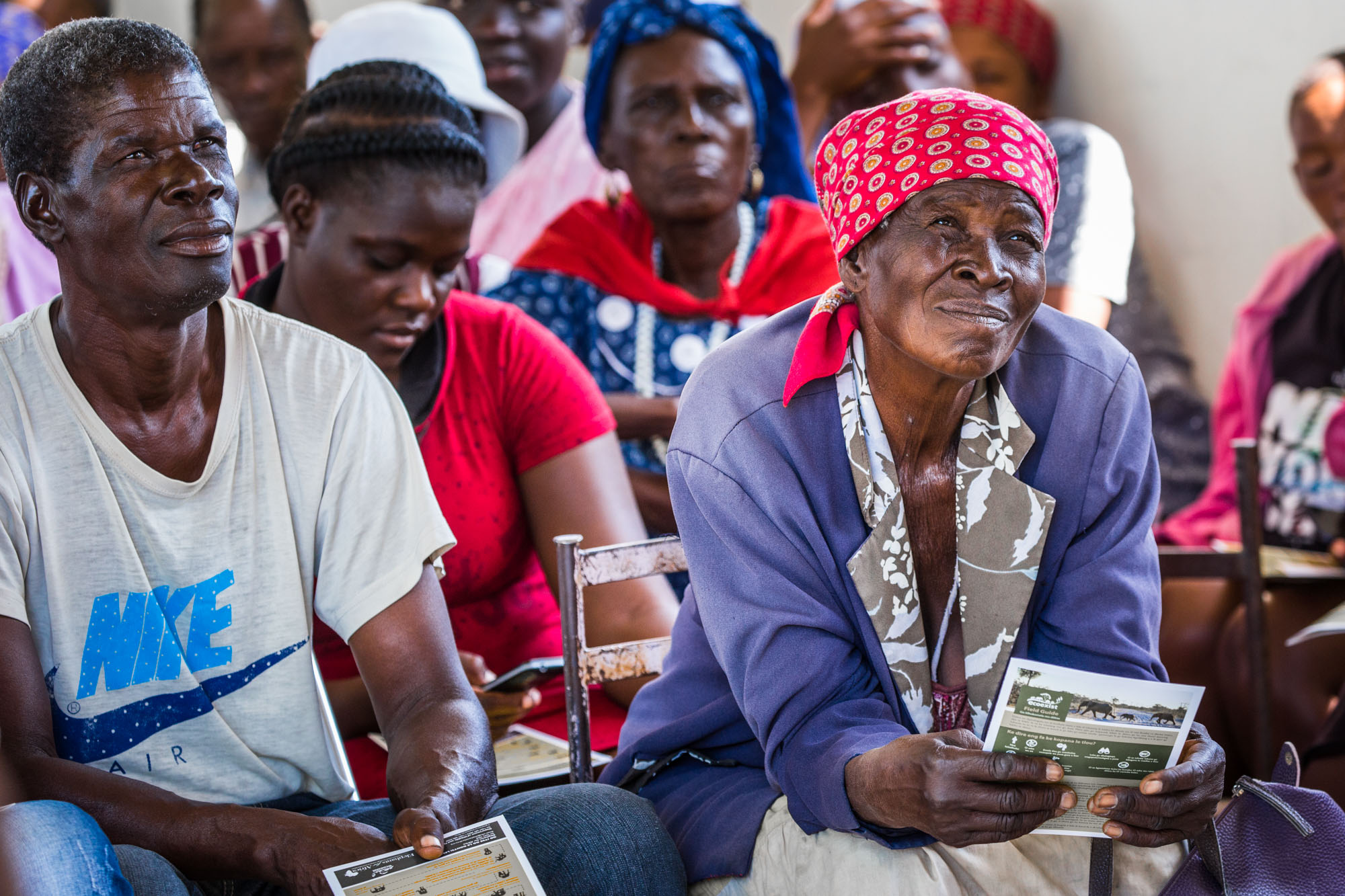 """""""People in Botswana have been living with wildlife longer than anyone in the world, probably 60 000 years or more,"""" says Dennis Sizemore, """"but a lot of the causes of the issues today were instigated during the colonial period."""" Locals at a community meeting in Motopi Village, near to the Boteti River."""