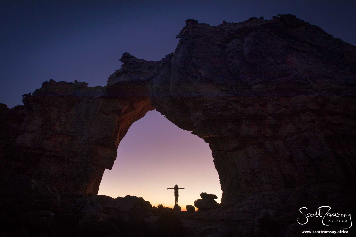 My friend Pippa Ehrlich greeting the numinous dawn at the Wolfberg Arch.