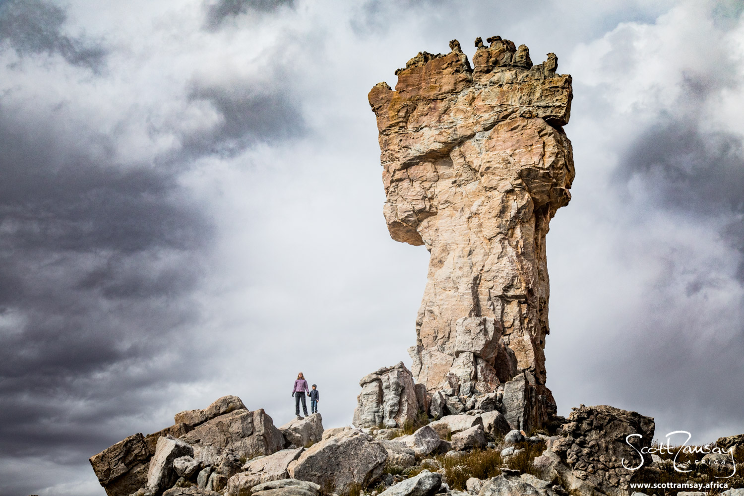 My fellow explorers Jax and Gabriel Davis dwarfed next to the Maltese Cross, one of several spectacular rock formations in the Cederberg Wilderness three hours north of Cape Town