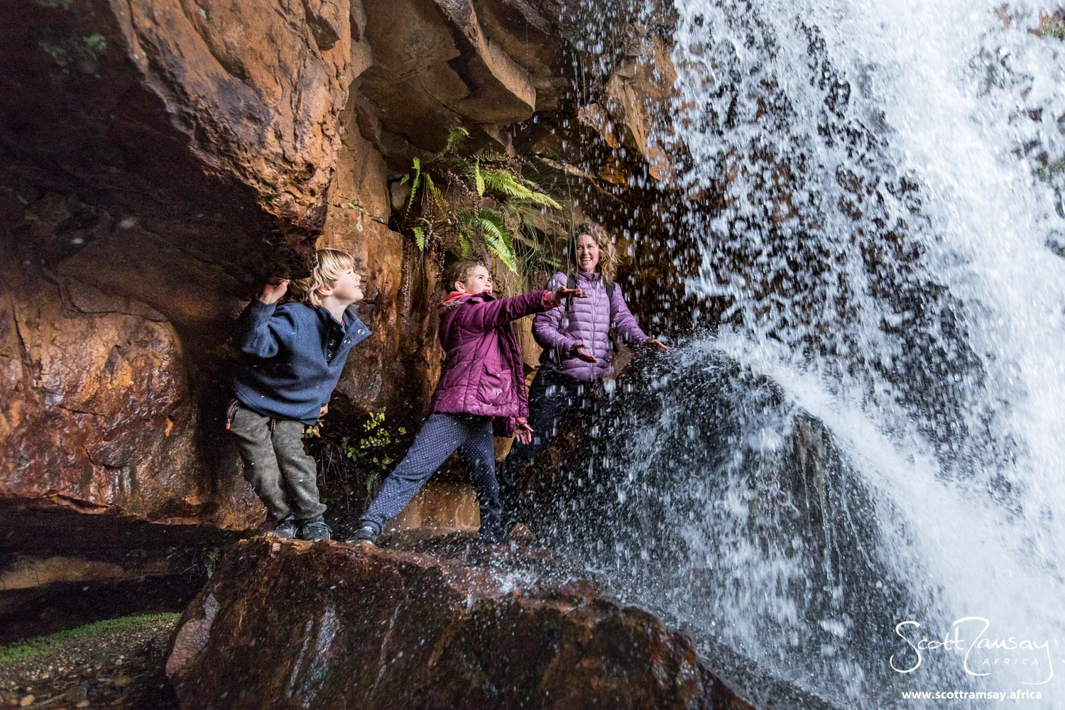 My friends Gabriel, Azara and Jax getting elemental with the surging rivers and waterfalls of the Cederberg in winter.