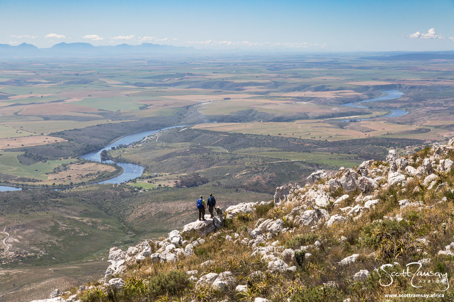 Looking out from the top of Potberg mountains ver the wheatfields of the Overberg near the southern tip of Africa. The Breede River below is full from a wet winter.