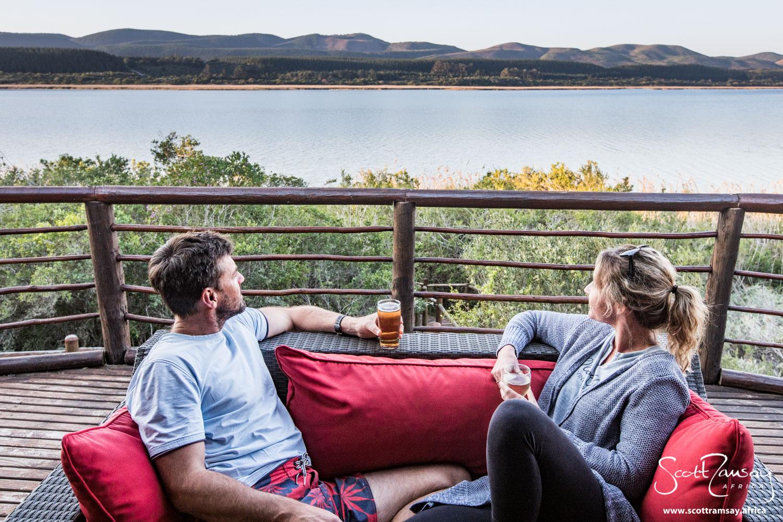 Joni and Ian enjoying a sundowner on the deck at Mvubu Lodge, overlooking Groenvlei