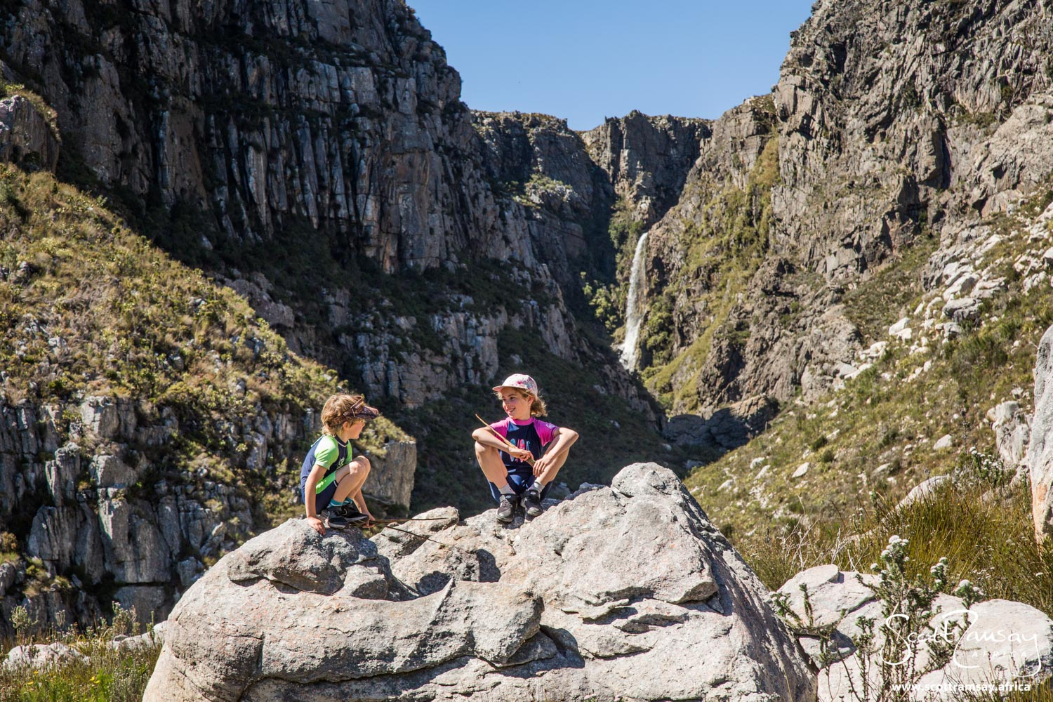 Intrepid young explorers Gabriel and Azara Davis, taking a break in the Bobbejaansrivier gorge in Limietberg