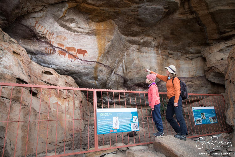 Friends Jax and Azara Davis admiring the Stadsaal rock paintings.